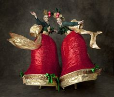 Christmas Belles - Red Xmas Stilt Bells  from www.FlamingFun.com Call 07788732552 for more info.