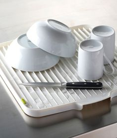 Reversible Double Side Draining Board allows you to drain the washing up virtually anywhere and is perfect for creating additional draining space when required. Both sides of the board have sloping ribs that prevent water being trapped in the mouths of upturned cups and bowls. http://zocko.it/LDFrj