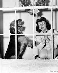 Mary Martin w/ airedale makes a wish.