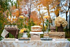 hay bale wrapped in burlap ribbon and wood blocks wrapped in ribbon and jute, pie scooped into glass jars ...cute!