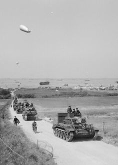 A British armoured column moves off from Gold Beach, Normandy, 7th June 1944