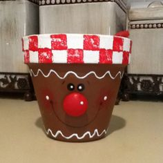 Gingerbread Man terra-cotta pot – would look adorable in the kitchen! Gingerbread Man terra-cotta pot – would look adorable in … Flower Pot Art, Clay Flower Pots, Flower Pot Crafts, Gingerbread Crafts, Gingerbread Decorations, Christmas Gingerbread, Gingerbread Cookies, Clay Pot Projects, Clay Pot Crafts