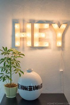 Construct a light-up marquee sign in the shape of whatever word you choose.