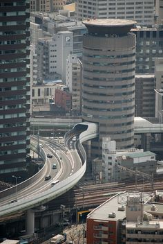 Gate Tower Building in Osaka, Japan. The 5th, 6th and 7th floors of this 16-story office building is occupied by an express highway - passing right through the building.
