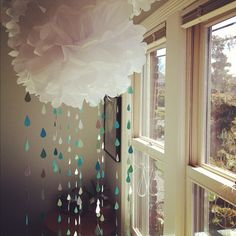 Indoor rain - lovely large pompom cloud with paper raindrop garlands. I love this but we have enough rain that I wouldn't want to introduce it indoors as well!