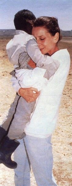 Audrey Hepburn hugging a child while on a mission trip with UNICEF. You can see the love and empathy on Audrey's face. Beautiful