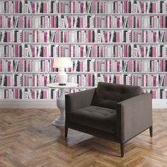 Fashion Library Bookcase Wallpaper - Pink - 139501  This fantastic Fashion Library Bookcase Wallpaper by Muriva will make a great feature in any room. The bookcase design features realistic looking books filling the shelves in natural tones of black, white and grey with glitter highlights and certain elements picked out in pink for added effect. Easy to apply, this high quality vinyl wallpaper will look great when used to decorate a whole room or to create a feature wall. Stunning bookcase…