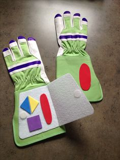Buzz Lightyear Toy Story Gloves. Found the green and white gardening gloves at dollar store. Colored fingers with a sharpie and glued felt and foam embellishments on.  Panel closes with a Velcro tab.