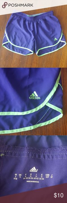 Adidas Lightweight Running Shorts Adidas purple and neon green lightweight running shorts with elastic waistband. Good condition no flaws. adidas Shorts
