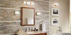 "GUIDE: How to light the bathroom. To avoid shadows, and fully surround your face with flattering light, install a fixture at least 24"" wide over the mirror, plus wall sconces on each side of the mirror, at least 28"" apart and 60"" above the floor. If you have a double sink vanity with a single mirror, use a light that is almost as wide"