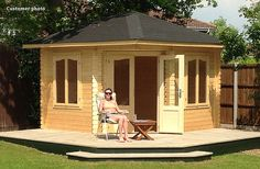 This decking (around the popular Lovat timber summerhouse by GardenLife Log Cabins) has a clean crisp feel and it's proportions are based on the footprint of the summer house. The simple addition of a small step, and green painted side walls help highlight summer house.