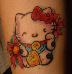 Winking Hello Kitty Tattoo - Cool Tattoo Ideas and Pictures Enjoy! http://www.tattooideascentral.com/winking-hello-kitty-tattoo/