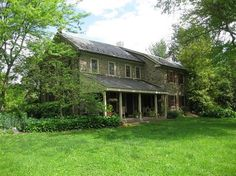 Stone Farmhouse, love this, add a long backporch, an upper level balcony off master screened in, and maybe a mudroom/laundry to garage