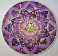 This Mandala represents the Crown Chakra. It is the connection we have with our higher source. It is painted in colors of indigo, purple, and