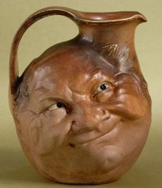 Moon Face Jug - Highly unusual piece Wow.....strange.....almost looks like it has been carved out of wood......CF