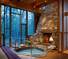 Jacuzzi with fireplace and glass wall