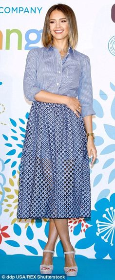 Beauty in blue: The Sin City starwore a light blue striped shirt teamed with a skirt in a...