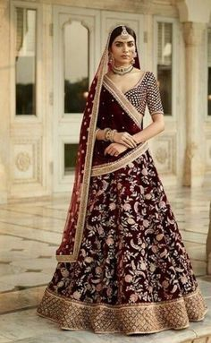 This dark burgandy colour wedding lehenga set is inspired by Sabyasachi Collection. Lehenga set is in velvet silk fabric with zardozi, marodi and arri hand embroidery. This lehenga set comes with one velvet shawl and one net dupatta as shown in the photo. Indian Bridal Couture, Indian Bridal Lehenga, Indian Bridal Outfits, Indian Bridal Wear, Bridal Dresses, Anarkali Bridal, Wedding Outfits, Ghaghra Choli, Bridal Lehenga Collection