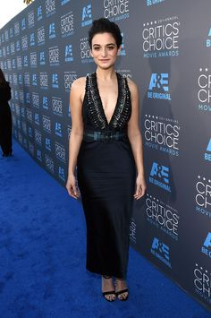 Jenny Slate in a plunging black dress with beaded detailing.