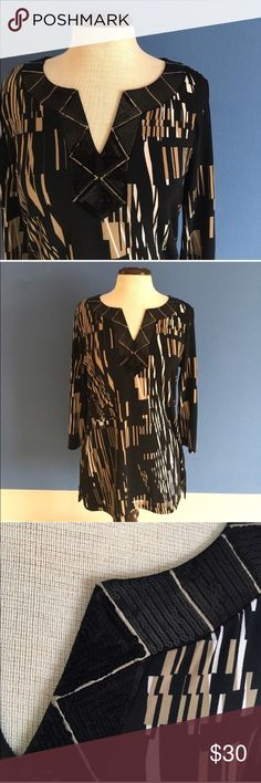 """Dana Buchanan Contemporary Blouse Hello!  This blouse is unique and pretty. The V-Neck is aligned with black. sequin. The blouse is comfortable and flattering.  Material: Polyester and Spandex.  Measurements (Flat):  Length - 28.5""""/Bust - 20.5""""/Waist - 18.5"""" Dana Buchman Tops Blouses"""