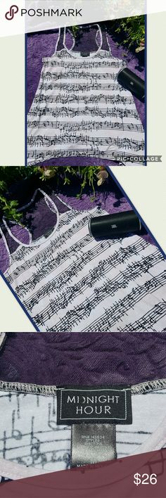 """♬MUSIC LOVERS THIS IS AN ADORABLE TANK♬ I absolutely love this tank, simple but cool. ♬ Cool blush with black colors, topped with sexy lace at top, with long drapped sides. Perfect for concerts and beach, pair with your favorite shorts.  ♫SIZE MEDIUM  ♫ARMPIT TO ARMPIT 17"""" ♫ARMPIT DOWN LENGHT 20""""  💛I LOVE TO CONSIDER ALL REASONABLE OFFERS.  ♫NO TRADES  ♫NO LOW BALLERS 🏁PLEASE NOTE THAT THE COLOR MAY DIFFER SLIGHTLY DUE TO LIGHTING WHEN TAKING PHOTO. MIDNIGHT HOUR Tops Tank Tops"""