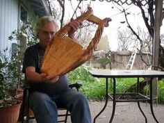 (13) Ancient Olive Wood King David Lyre - YouTube  In BY THE WATERS OF BABYLON, Merari's husband was a harp maker, and she takes over his trade when he is taken captive to Babylon. Pictured in this video is a LYRE, but harps in 6th-century BC Jerusalem would have been made of similar wood and string construction.