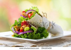 Healthy plate of chicken tortilla served outside