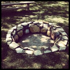 Dig a hole and surround with river rock. DIY for free!! We are doing this :)