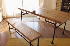 Reclaimed Wood Dining Table With Industrial Iron Pipe Legs