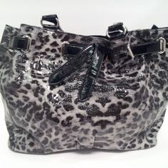 Grey Leopard Purse- Front - Jewelry • Hats • Purses • Shoes • Scarves • Dresses • Skirts • Pants • Shirts • Pet Apparel & Accessories • Candles • Art • And so much more!!!  We have new and gently used clothing. You can order from us online or come shop our retail store Mon-Fri 8am-5pm Sat 9am-Noon all month long! We are located 5612 SW Topeka Blvd. Topeka, KS inside House 2 Home. We have a lot of items in the store that are not on the website.