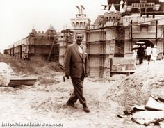 Walt Disney inspecting the Disneyland Castle, under construction; May 1955.