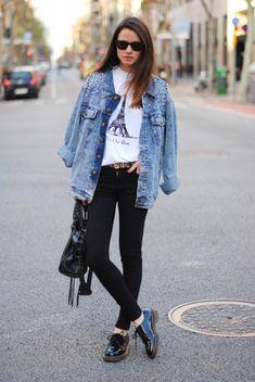Women's Light Blue Embellished Denim Jacket, White Print Crew-neck T-shirt, Black Skinny Jeans, Black Leather Satchel Bag, Black Leather Oxford Shoes, and Black Sunglasses