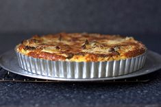 Hands down ... this is the most delicious thing you'll ever put in your mouth ... that isn't dessert. ;) Cauliflower and Caramelized Onion Tart smittenkitchen.com