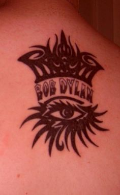 my first tattoo. bob dylan's tour logo. love the tribal!