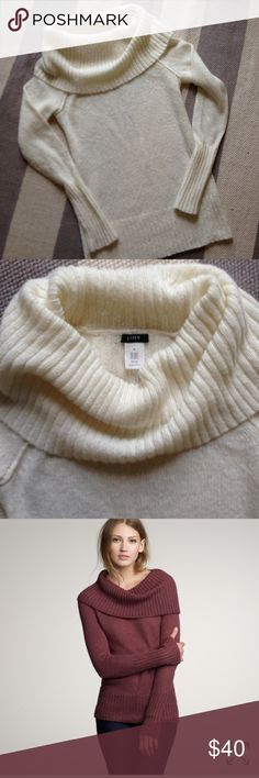 J crew chalet dramatic collar sweater This j crew chalet sweater is in EUC. Dramatic neckline that is slightly off shoulder-cozy, sexy, and in a lovely off white. Smoke free home with pets. J. Crew Sweaters Cowl & Turtlenecks