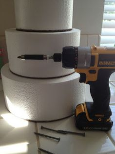 How to make a fake cake. Would do at least two layers real that way you can get the top layer for your one year!