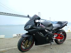 2002 Honda CBR f4i refurbished in matte black with red tint...