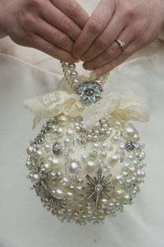 Ivory Jewelry Bouquet / Pomander - you could buy beads and old costume jewelry at Goodwill, etc. and pin them to the foam balls.  Might not be cheaper than flowers...