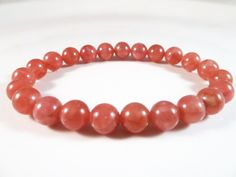 Peruvian Rhodochrosite Stretch Bracelet 8mm Smooth Round AAA High Quality Gemstone Beads by SandiLaneFineArt on Etsy
