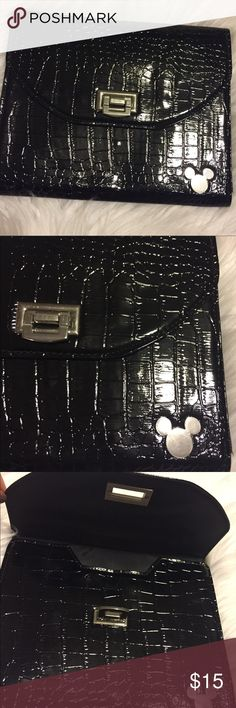 Disney Mickey Black Evening Clutch From smoke and pet free environment. This Beautiful Disney Black Clutch is never been use. Stored to my closet the whole time. There's Mickey Mouse Logo infront Of this ba. Very classy. Bags Clutches & Wristlets