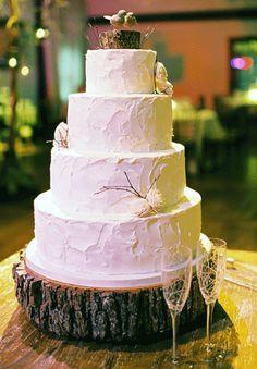Rustic pink wedding cake on wooden slab. jill totten