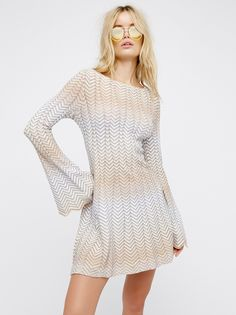Bella Sweater Mini Dress | Inspired by decades past this chevron designed mini dress features a swingy skirt. Full statement bell sleeves with uneven trim and a rounded neck.