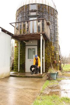 Converted silo on a farm. They've put in three stories—kitchen/bath at the bottom, office/sitting room above (where the balcony is), bedroom at the top. It's all connected by a staircase that spirals around, and the sound of rain on the roof is lovely.