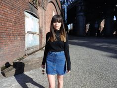 Button front denim skirt with black polo neck and lace up flats on The Monochromes