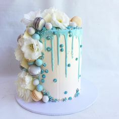 Layered floral cake with dripping