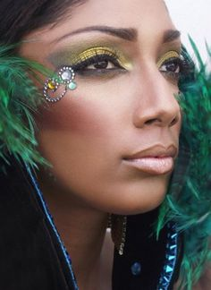 Carnival inspired golden eye shadow with crystal swirls and feathers.