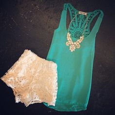 Summer style: teal tank with white lace shorts and a statement necklace
