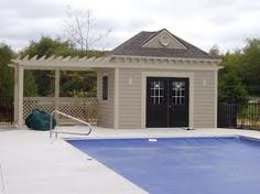 Pool house with pergola on side