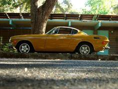 yellow car - volvo p1800