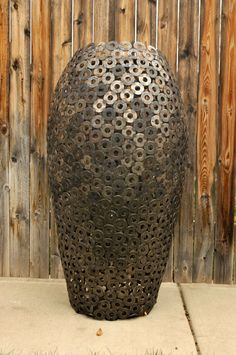Large metal sculptural vase - hand welded from from steel structural washers.  Make a statement in your home with this industrial artwork!
